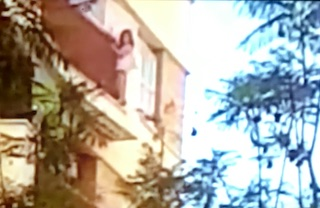 AND Child on a Balcony
