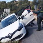LHR Car hangs off side of road