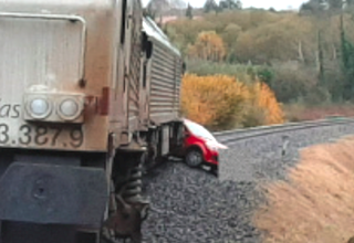 SPN Car driving along Rail tracks hit by train