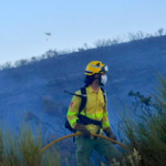 ECO Infoca Loan fire fighter with helicopter in the background